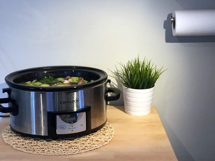 Bone broth recipe ingredients in slow cooker