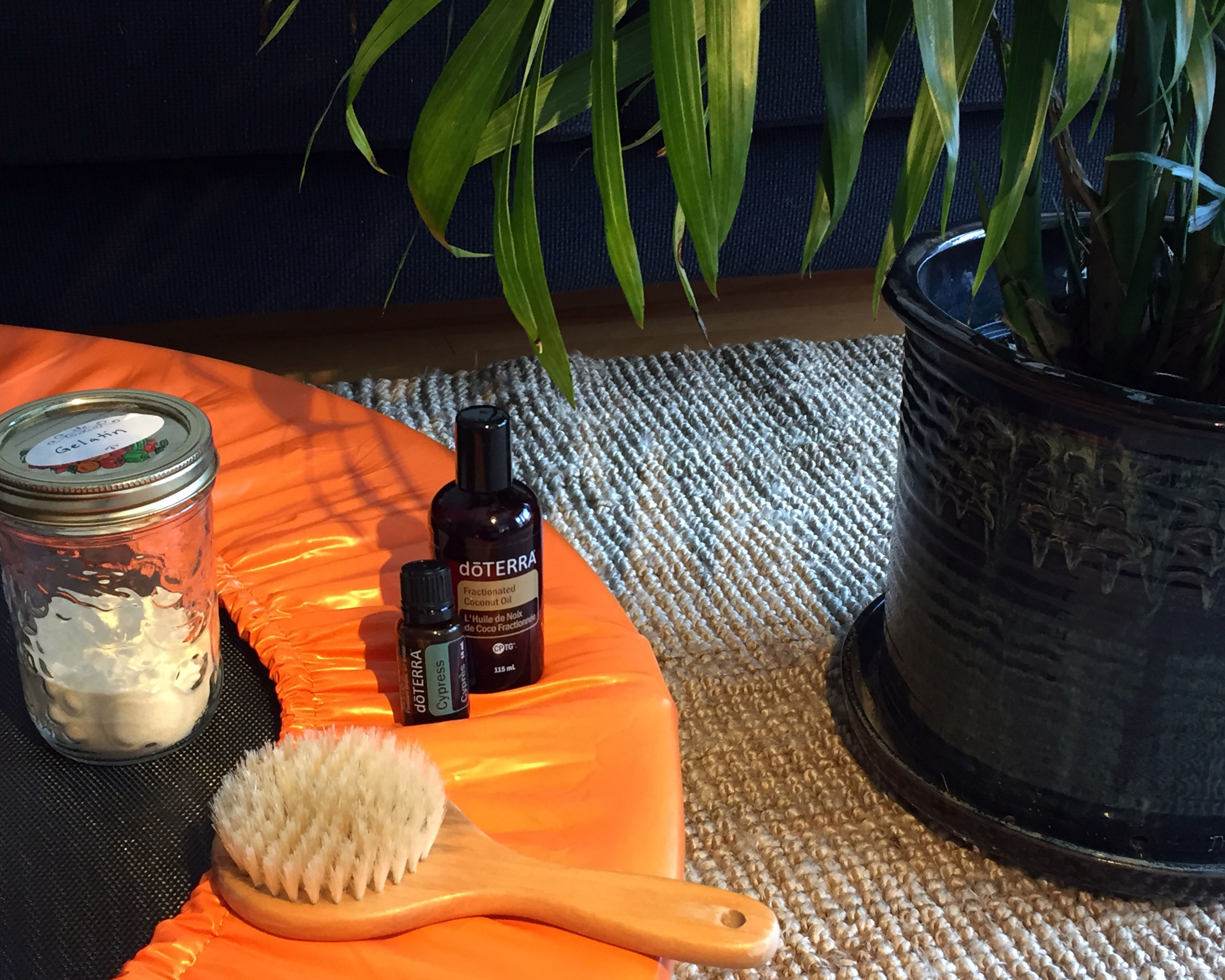 Mini trampoline, gelatin, dry skin brush, cypress essential oil and fractionated coconut oil