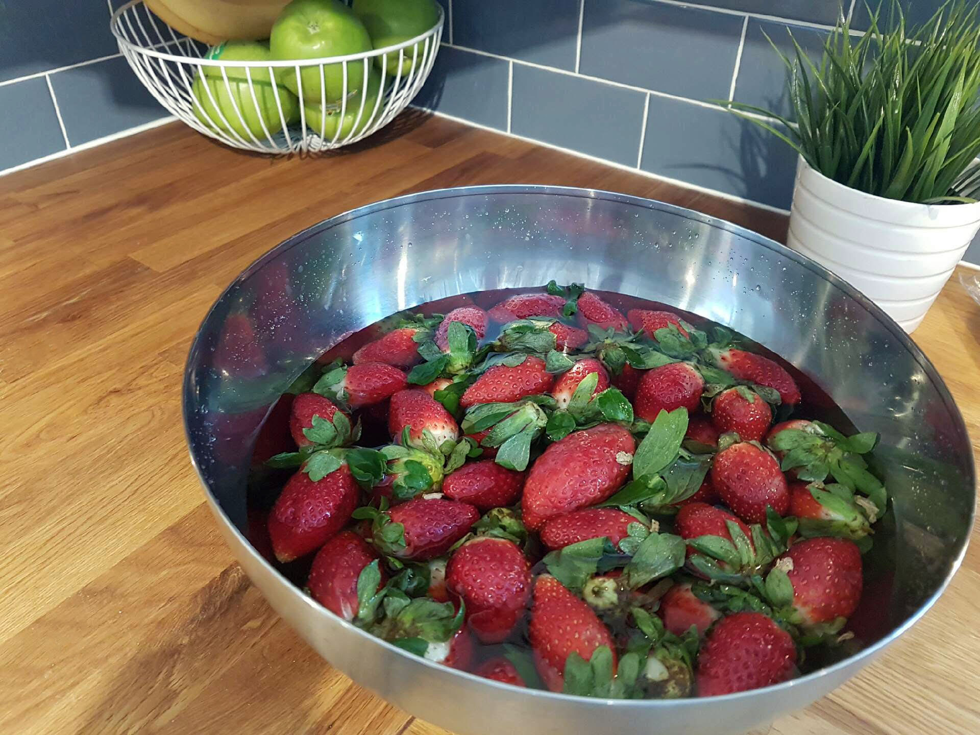 Strawberries in fruit and veggie soak