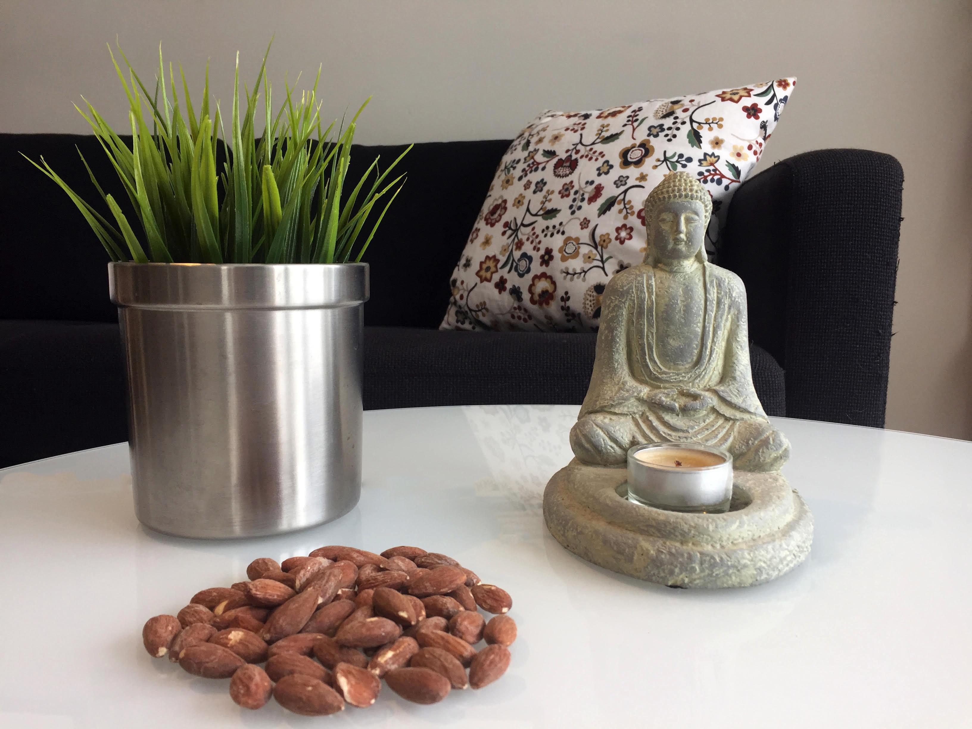 Plant, almonds and a buddha