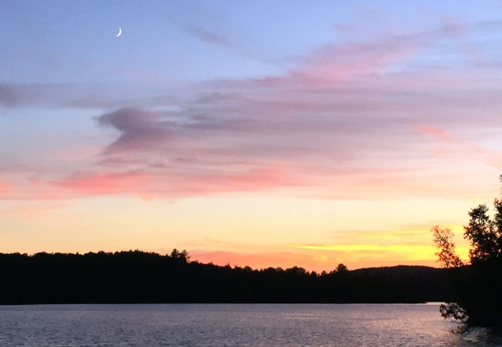 Picture of the evening sky, overlooking the lake, on an island in the forest